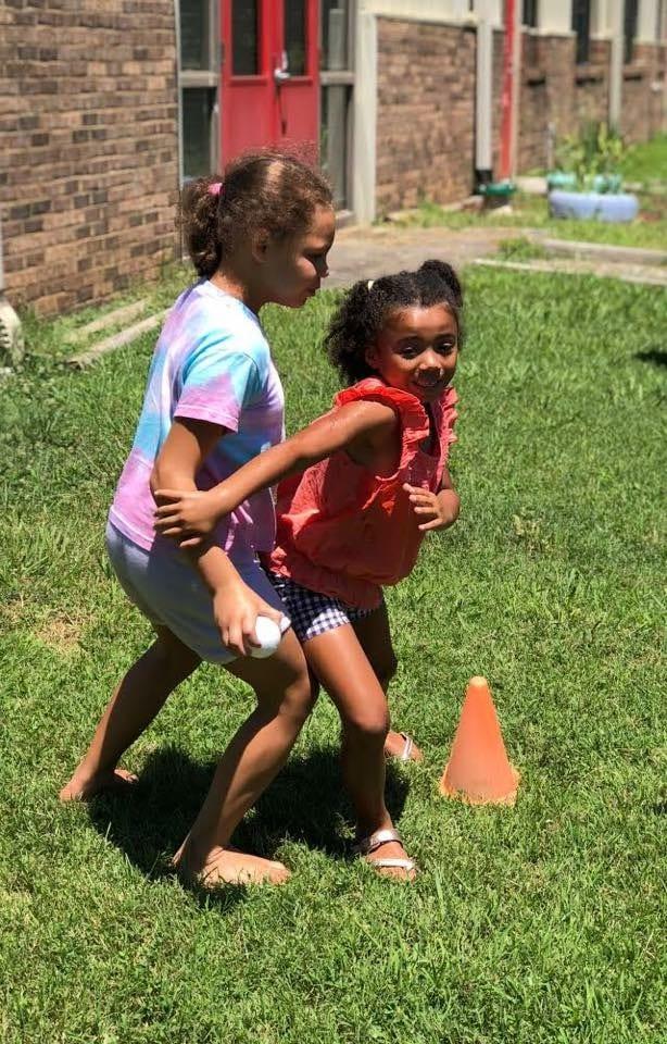 girls inc playing outside